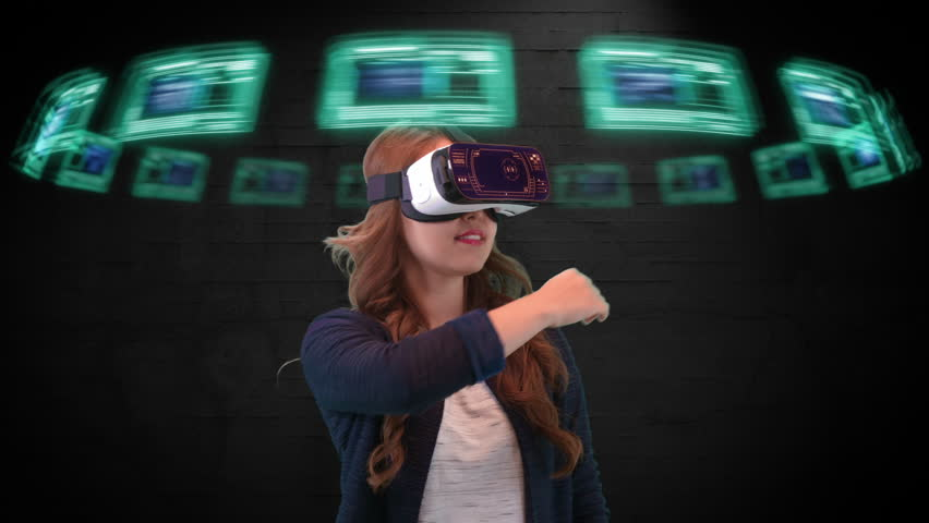 Young Asian female wearing virtual reality goggles uses futuristic holographic interface to access digital data | Shutterstock HD Video #18671783