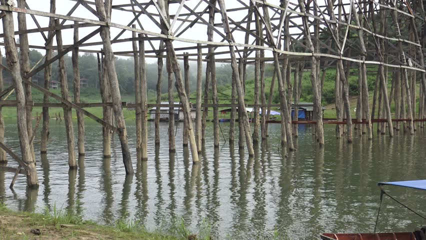 kanchanaburi thailand july 18 unidentified young man jump out of the high wooden bridge - Bamboo Garden 2016