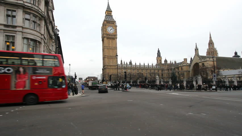 LONDON, UK - DECEMBER 27: Public bus and other traffic drives past Big Ben in London on December 27, 2011. Big Ben is the clock tower of Westminster Parliament.