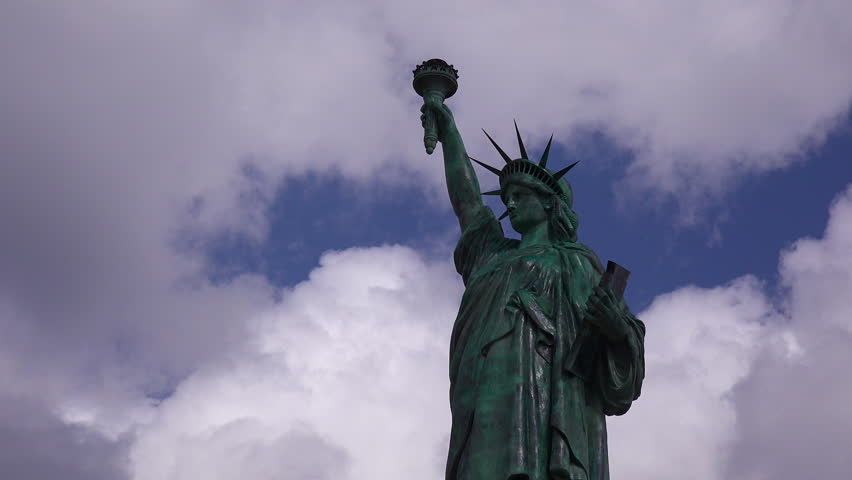A patriotic shot of the Statue Of Liberty against a cloudy sky. (Alabama 2010s) | Shutterstock HD Video #18687338