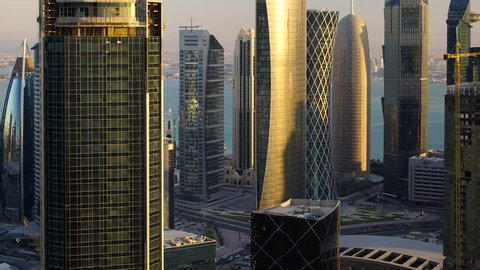 Panning up the new skyline of the West Bay central financial district of Doha, at sunset, Doha. Qatar, Middle East