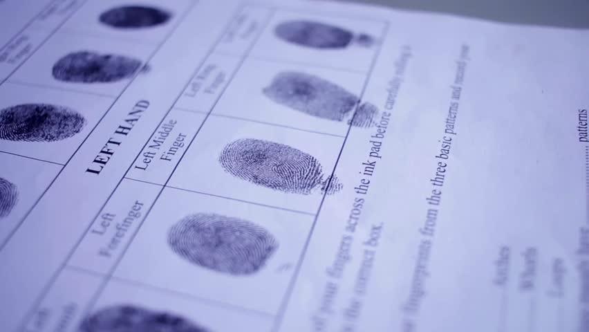 Fingerprint on police fingerprint card | Shutterstock HD Video #18737498