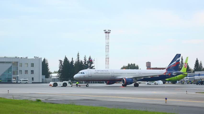NOVOSIBIRSK, RUSSIAN FEDERATION - AUGUST 21, 2015: Aeroflot Airbus 321 VQ-BKS named I.Kramskoy towing before take-off, Oficial spotting in Tolmachevo airport (OVB) , on Aug.21, 2015