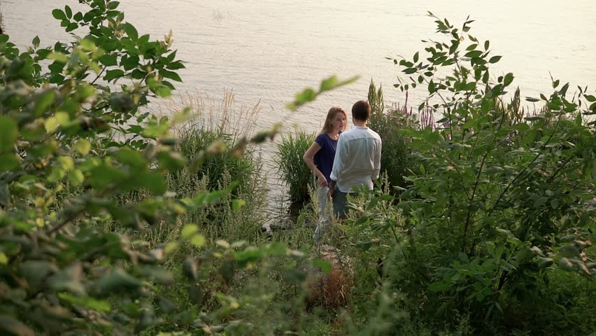 Couple in love by the river | Shutterstock HD Video #18765173
