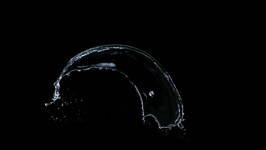 Slow-motion splash water against black drop shooting with high speed camera, phantom flex.