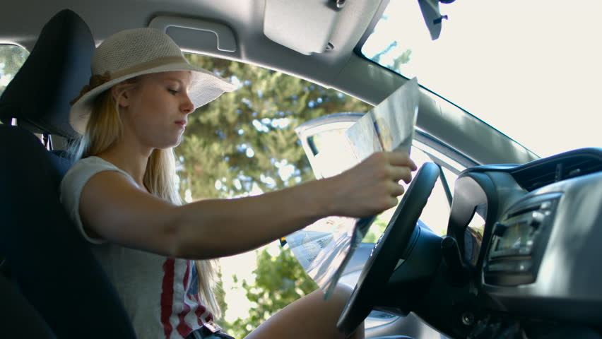 Girl Reading Map for Directions Stock Footage Video (100% Royalty-free)  18784568 | Shutterstock