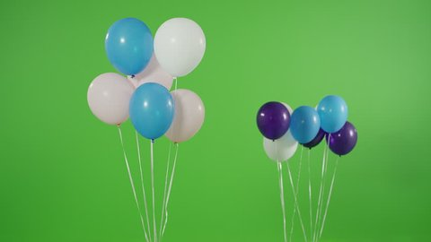 4K Many helium balloons rise up on green screen. Shot on RED EPIC Cinema Camera.
