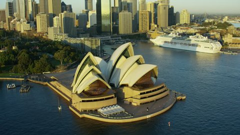 Sydney Australia - 2016: Aerial Opera House sunrise Ferry Harbor Harbour Skyscrapers Cruise Ship Circular Quay Cityscape Building Exterior travel tourism vacation RED DRAGON