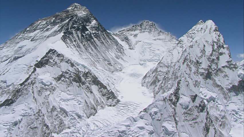 Unique Aerial Shot of the south face of Mount Everest and the Khumbu Icefall on a sunny day in Himalaya - Nepal, Tibet
