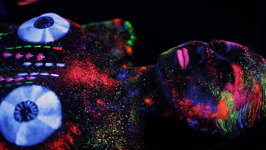Hands DJ govern painted fluorescent powder on the body of a naked girl decks | Shutterstock HD Video #18820808