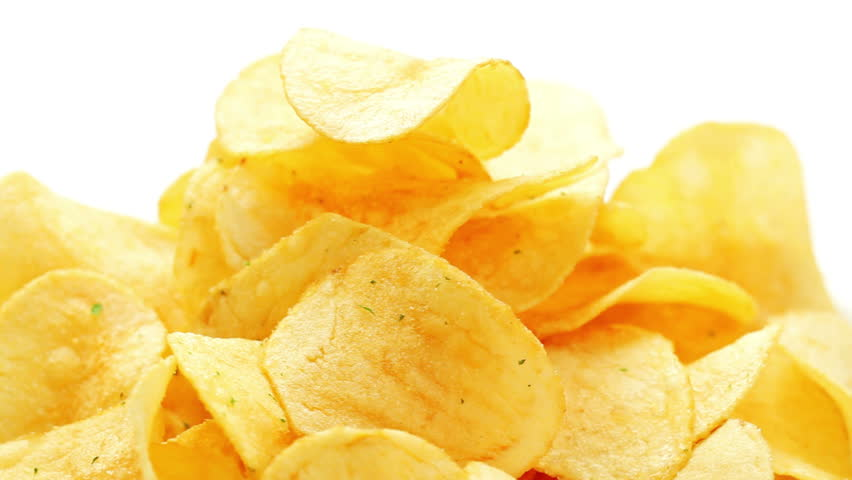 Potato chips heap rotating over white background, macro view | Shutterstock HD Video #1882516