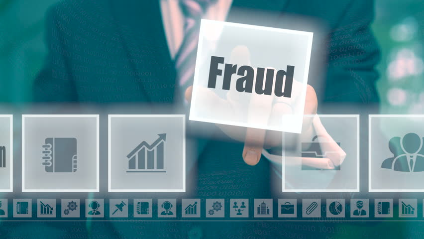 Businessman pressing an Fraud concept button on a blue background | Shutterstock HD Video #18841028