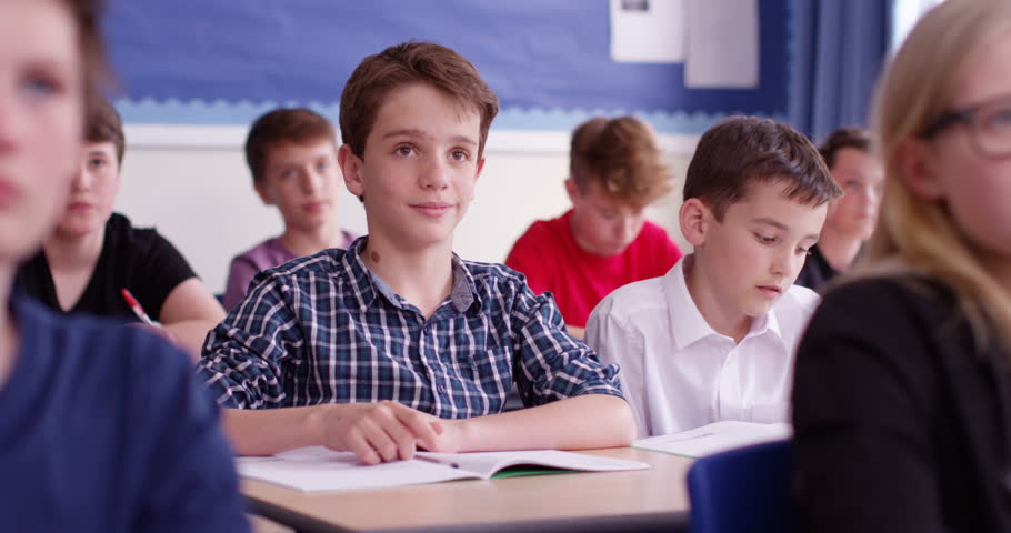 4k, students in class with their arm raised to answer a question. Slow motion. | Shutterstock HD Video #18843968