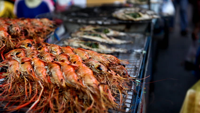 A lot of grilled shrimps and fish on the street of Bangkok, Thailand | Shutterstock HD Video #1885918