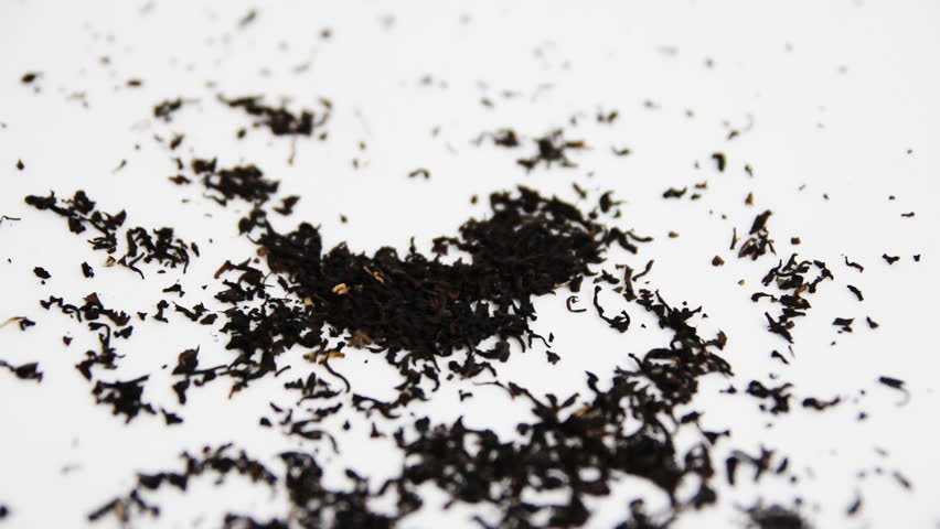 Tea crumbles to a white background