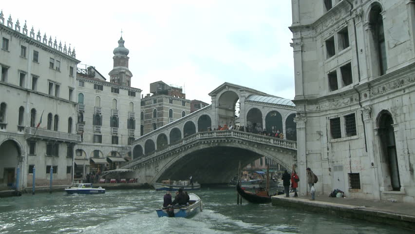 Boating through the Rialto Bridge on the Canale Grande on 24th of February in