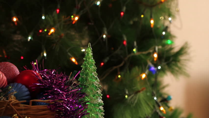Decorated Christmas Tree Rotating On Blinking Multicolor Bokeh  - Multi Color Christmas Tree Decorations