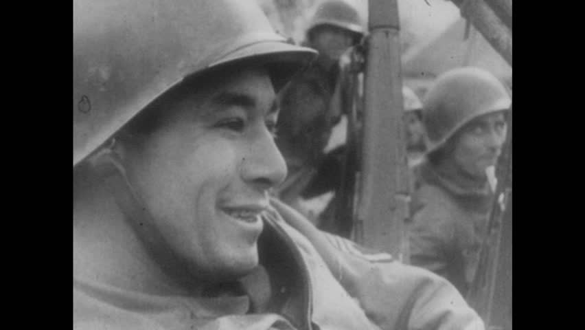 EUROPE, 1950s: Close up of soldier's face as he smiles and chats. Soldier chewing gum. Soldiers leaving the trench to go into battle. | Shutterstock HD Video #18935168