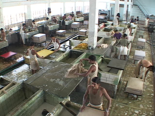 Workers mix and blend papers in a factory.