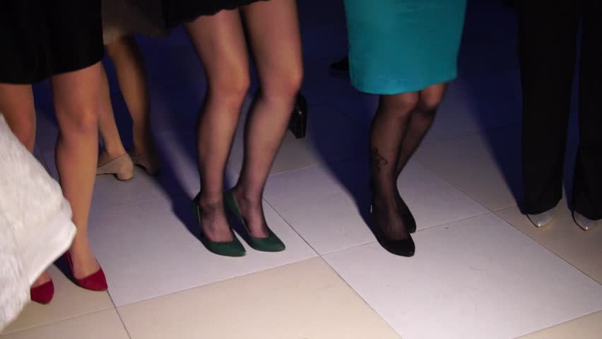 SLOW MOTION: Legs of people dancing a traditional Balkan dances at a wedding reception.
