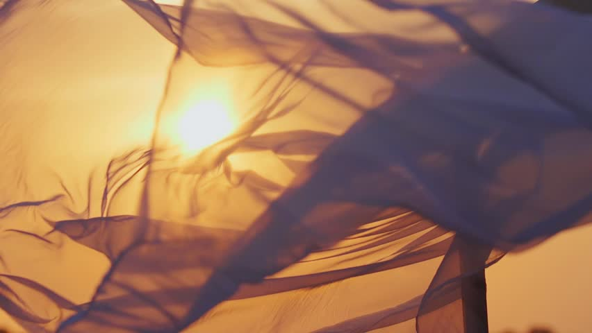 Fabric fluttering in the sunset