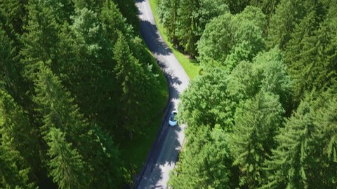 Aerial cinematography of an Audi R8 on a serpentine road near Tegernsee