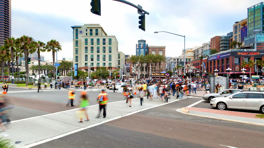 SAN DIEGO, CA - JULY 21: (Timelapse View) After a busy day, large crowds exit San Diego Comic-Con International on July 21, 2011.