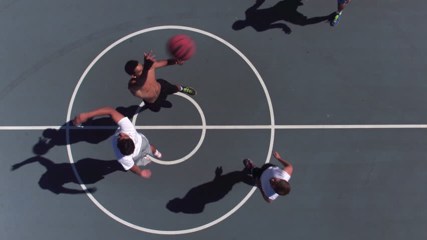 Friends playing basketball at park, overhead shot of tip off   Shutterstock HD Video #19001497