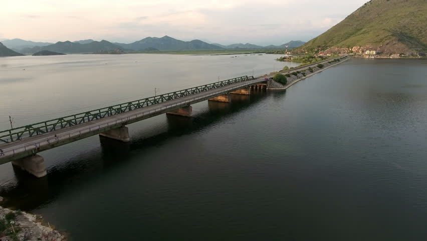 The Skadar lake and dam with railway and highway to Podgorica. Aerial view. Vranjine, Montenegro