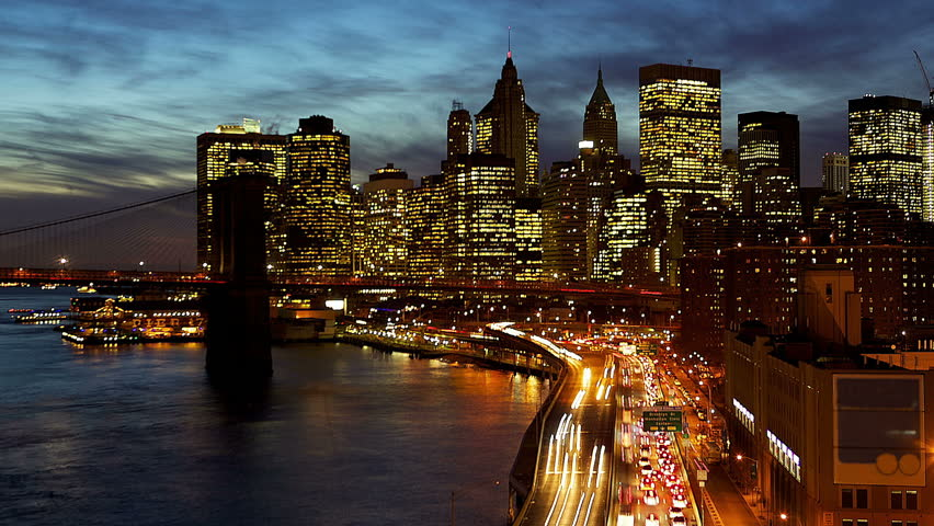 Busy traffic in New York City Manhattan with Brooklyn Bridge at dusk time lapse