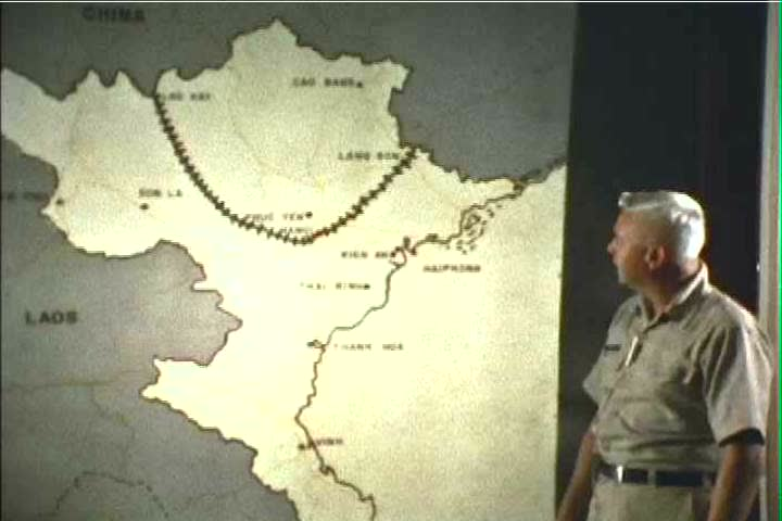 A Man Explains The Bombing Objectives Of The Us Air Force In Vietnam Using A Large