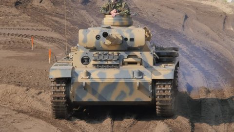 Military Tank driving on battle field