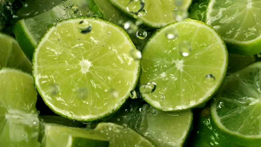 Limes Cut  with Water Drops Super Slow Motion