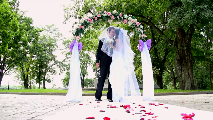 young couple kissing during their wedding ceremony.  dolly shot. Sequence