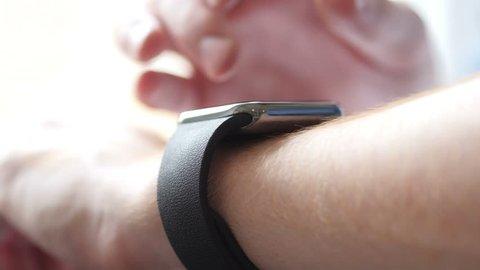 Close Up of Hand suing Smartwatch, Gadget