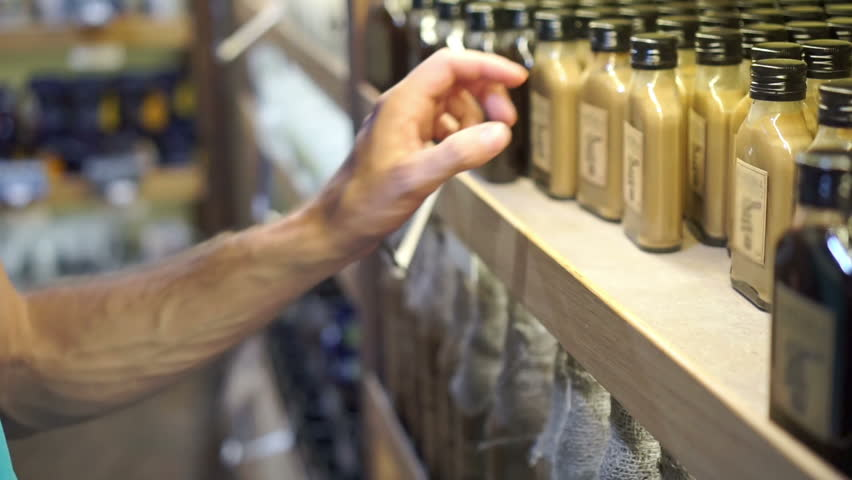 Man choose a drink in a store. Variety of different drinks on store shelf | Shutterstock HD Video #19169548