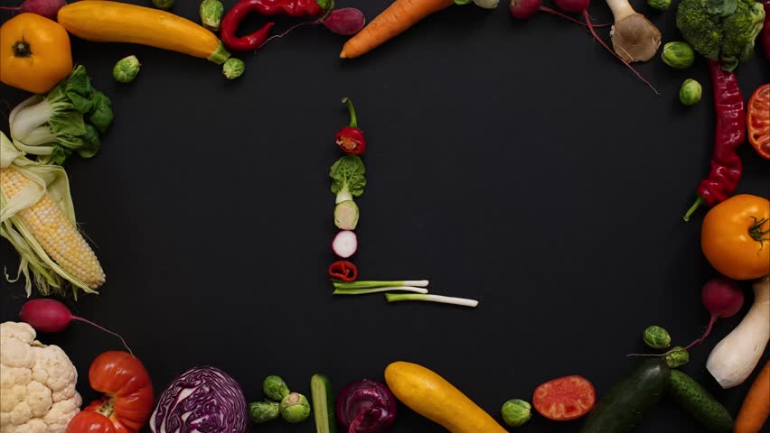 "letter ""L"" laid out in vegetables. Alphabet made of vegetables. Autumn harvest generates letters."