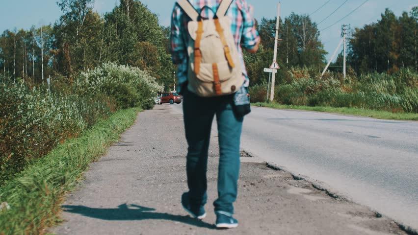Boy hitchhiking — img 9