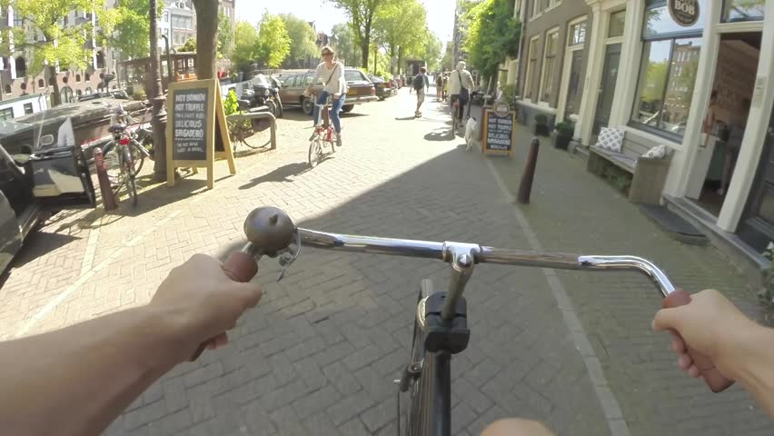 First person, POV bike ride through the historic city center of Amsterdam, The Netherlands on 25th August 2016.