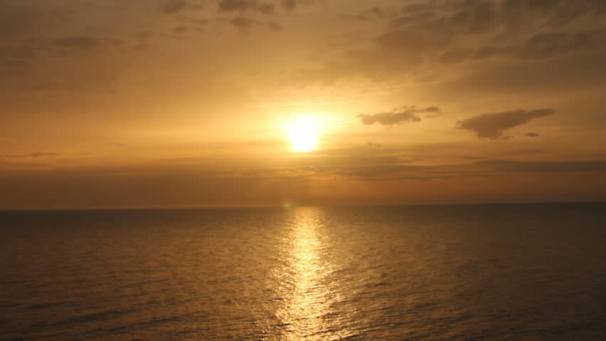 Sun in clouds over sea surface | Shutterstock HD Video #19207348