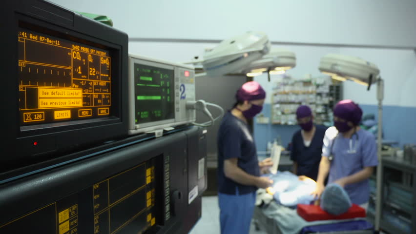 Team work with doctors, nurses, surgeons performing surgery on sick patient in hospital operation room