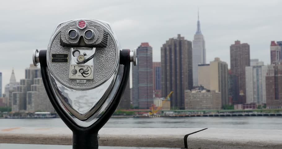 Binoculars and New York City Manhattan skyline with Empire State building in the background over East River viewed from Gantry Plaza State Park at daytime. #19214083
