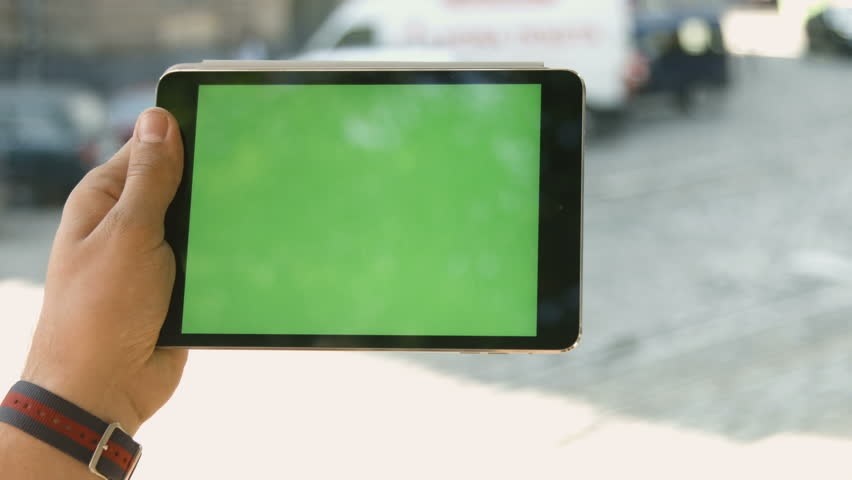 Man uses tablet pc on the street on a background sunset. | Shutterstock HD Video #19259908