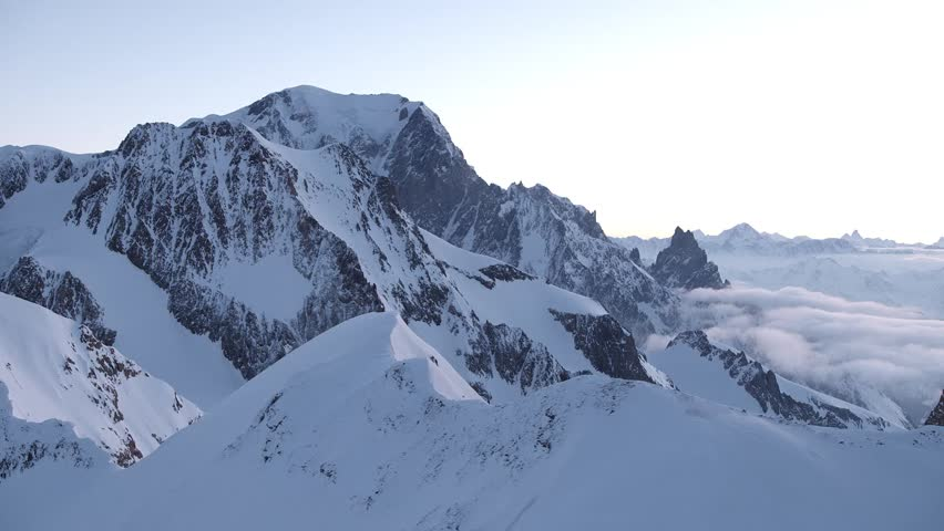 Slow Mo Aerial shot of snowy peaks and ridges in the morning in Courmayeur, Aosta Valley/Italy (Courmayeur, Aosta Valley/Italy - March, 2016)