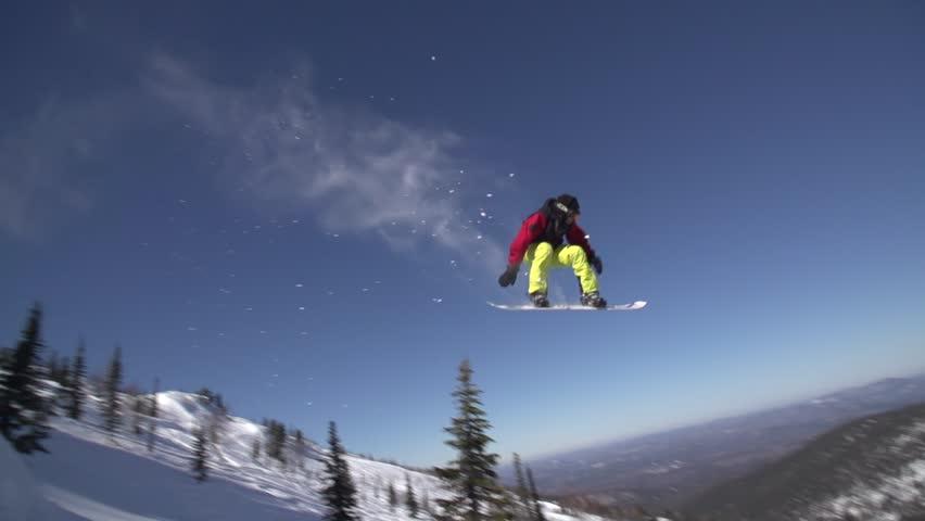 Snowboarder Slides In Mountain In Winter Day