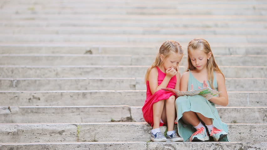 Adorable Little Girl Looking At Touristic Map On Steps In Italy - Map videos for kids