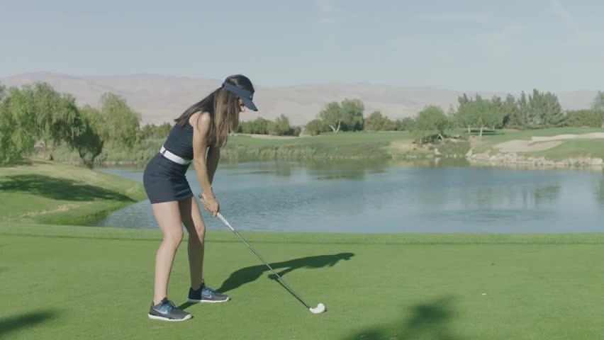 Professional golf player plays in Palm Springs at the amazing green golf course. SLOW MOTION. Shot on ARRI ALEXA. Very cinematic look