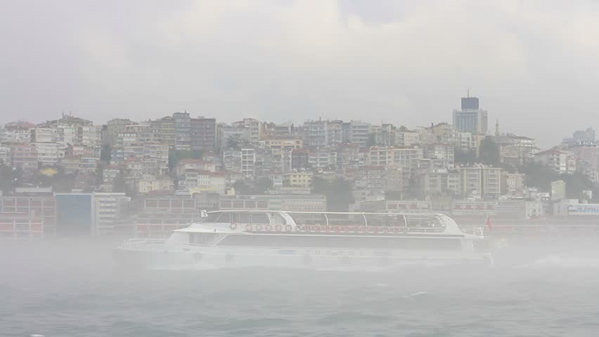 Ferry sailing past Istanbul Harbor in mist and fog above the water  #19288432