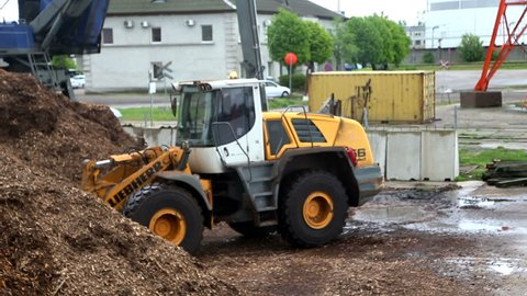 Liebherr Bulldozer with wood in port of Liepaja chips May 2016