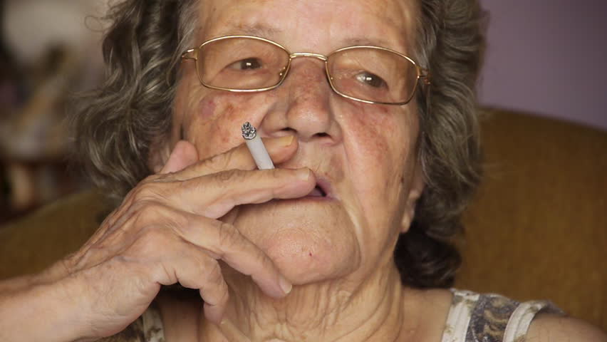 Old retired woman smoking cigarette - Unhealthy - Lifestyle - Addiction - Full HD